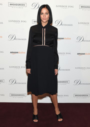Leigh Lezark paired her dress with black open-toe satin mules.