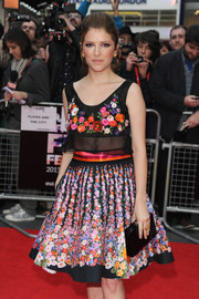 Anna Kendrick matched a black box clutch with her floral outfit for the 'Drinking Buddies' screening.