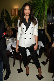 Irina Shayk went the masculine-chic route in a black-and-white tux jacket teamed with capri pants when she attended the Dsquared2 dinner.
