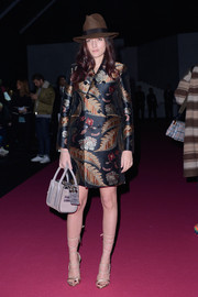 Eleonora Carisi went for sexy styling with a pair of gold lace-up heels.