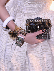 Eleonora Carisi completed her bling with an oversized white bangle.