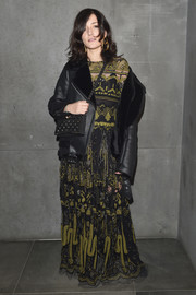 Eleonora Carisi styled her look with a studded black cross-body bag.