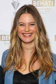 Behati Prinsloo looked fab with her center-parted, feathered waves at the launch of her Juicy Couture collection.