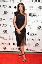 Cindy Crawford complemented her dress with black ankle-strap heels.