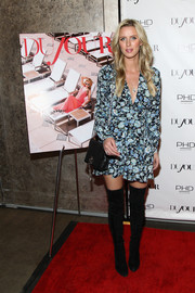 Nicky Hilton teamed her frock with a simple black leather bag.