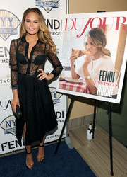 Chrissy Teigen was smoking-hot in a sheer black lace button-down during the DuJour Magazine party.