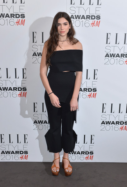Dua Lipa Capri Pants [clothing,shoulder,dress,red carpet,premiere,joint,little black dress,fashion,carpet,footwear,elle style awards,the elle style awards,london,england,red carpet arrivals,dua lipa]