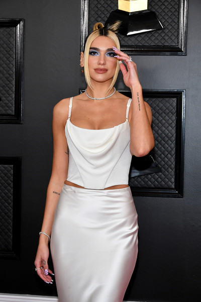 Dua Lipa Lettering Tattoo [clothing,white,shoulder,dress,cocktail dress,fashion model,fashion,waist,lady,beauty,arrivals,staples center,los angeles,california,dua lipa,annual grammy awards,dua lipa,grammy awards,future nostalgia,pop music,celebrity,new rules,red carpet]