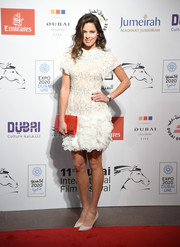 Ana Ivanovic made an appearance at the Dubai International Film Festival wearing a frothy white cocktail dress.