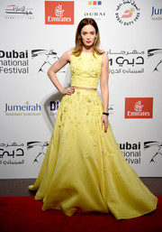 Emily Blunt brought the crop-top trend to the Dubai International Film Festival red carpet with this floral-embellished yellow number by Zuhair Murad.