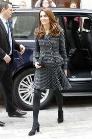 Kate Middleton was all business in a charcoal tweed skirt suit by Dolce & Gabbana at the Mental Health in Education conference.