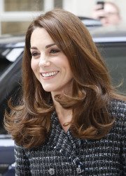 Kate Middleton attended the Mental Health in Education conference wearing her signature side-parted 'do with curly ends.
