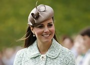 Kate Middleton showed us again why she is the queen of hats. The Duchess looked classy and chic in this curly-cue topper.