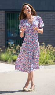 Kate Middleton was all abloom in a floral midi dress by Faithfull the Brand while visiting EACH Hospices.