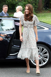 Kate Middleton looked summer-ready in a Ridley London print dress while attending a photography workshop with Action for Children.