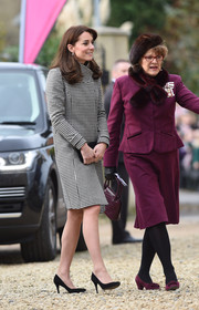 Kate Middleton opted for a classic and chic houndstooth coat by Reiss when she visited Action on Addiction.