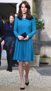 Kate Middleton was prim and proper in a long-sleeve aqua-blue Emilia Wickstead dress while visiting Action on Addiction.