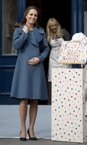 Kate Middleton attended an event at the Emma Bridgewater factory wearing a slate-blue wool coat by Sportmax.