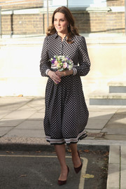 Kate Middleton was business-chic in a black-and-white print shirtdress by Kate Spade while visiting the Foundling Museum.