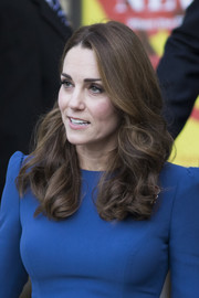 Kate Middleton wore her hair down in bouncy curls while visiting the Imperial War Museum.