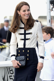 Kate Middleton visited Land Rover BAR carrying a classic quilted clutch by Jaeger.