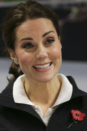 Kate Middleton pulled her hair back into a casual ponytail for her visit to the Lawn Tennis Association.