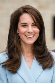 Kate Middleton framed her face with this side-parted 'do with flippy ends for her visit to the Drai Eechelen Museum in Luxembourg.