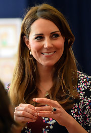 The Duchess showed off her long natural locks with this straight 'do.