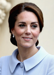 Kate Middleton complemented her elegant updo with a pair of pearl and diamond earrings borrowed from the Queen.