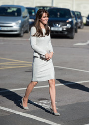 Kate Middleton looked sophisticated in a long-sleeve tweed dress.