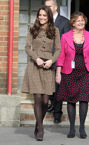 Kate Middleton complemented her winter weather style with brown suede ankle boots.