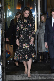 Kate Middleton charmed in a floral midi dress by Orla Kiely at the 'Victorian Giants' exhibition.