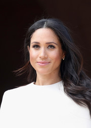 Meghan Markle wore her hair loose in a subtly wavy, center-parted style during her first official engagement with Queen Elizabeth II.