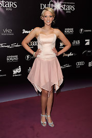 Model Sarah Knappik attended Duftstars 2010 wearing a soft and feminine cocktail dress. Silver ankle strap sandals completed her look.