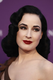 Dita Von Teese hit the 2012 Dufstars Awards in Germany wearing a rich merlot shade of lipstick.
