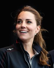 Kate Middleton complemented her 'do with a pair of dangling heart-shaped diamond earrings.