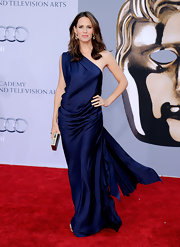 Jennifer Garner was breathtaking at the BAFTA Brits to Watch event. The brunette actress donned a silk midnight blue evening gown with Old Hollywood draping and a dramatic wind-blown train. Jennifer accessorized with gold earrings and carried a box clutch for the occasion.