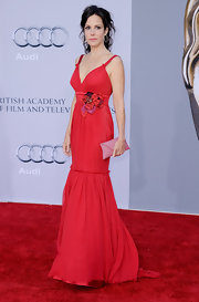 Mary-Louise Parker was a vibrant beauty at the BAFTA Brits to Watch Event in a summery chiffon evening gown with a floral bust piece. The actress wore her hair up in messy curls and carried a sparkling pink clutch.