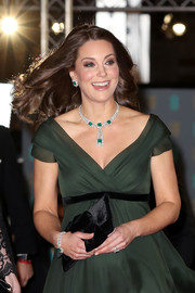 Kate Middleton complemented her green dress with an emerald and diamond bracelet and a matching necklace and earrings.