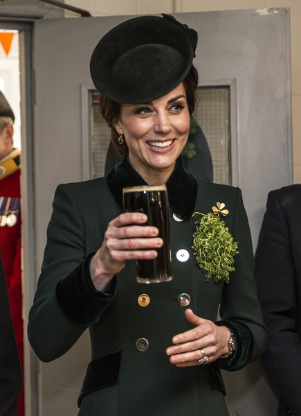 Kate Middleton adorned her green coat with a gold shamrock brooch by Cartier for a St. Patrick's Day parade.