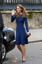 Kate Middleton kept it demure in a long-sleeve navy midi dress by Emilia Wickstead at the launch of the National Emergencies Trust.
