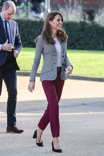 Kate Middleton teamed berry-hued trousers by Joseph with a gray blazer for the Shout's Crisis Volunteer celebration.