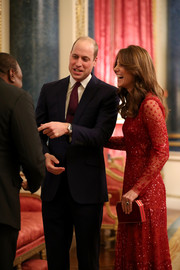Kate Middleton accessorized with a red Jenny Packham clutch while attending a reception to mark the UK-Africa Investment Summit.
