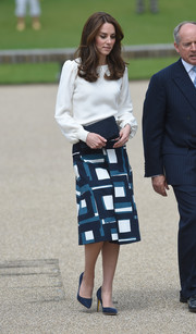 Kate Middleton paired her blouse with a geometric-print skirt by Banana Republic.