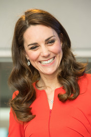 Kate Middleton wore her hair down in bouncy curls at the opening of the Global Academy.
