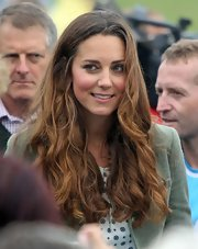 Kate Middleton dazzled with slightly ombre waves during her first public appearance after giving birth.