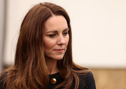 Kate Middleton visited the 282 East Ham Squadron, Air Training Corps wearing a loose straight hairstyle with a side part.