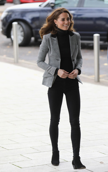 Kate Middleton looked fall-ready in a gray Smythe blazer layered over a black turtleneck while visiting Basildon Sporting Village.