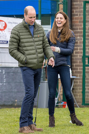 Kate Middleton teamed blue skinny jeans with a puffer jacket for her visit to the Cheesy Waffles Project.