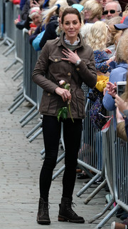 Kate Middleton kept it casual in a brown Troy London utility jacket teamed with skinny jeans while visiting Cumbria.